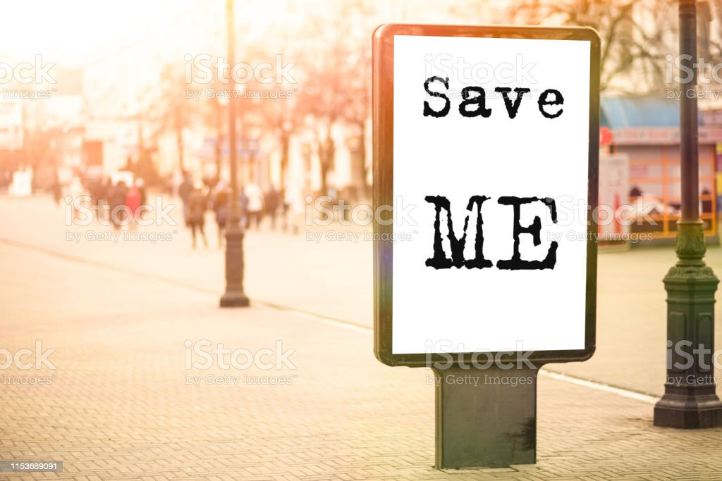 text Save me on an advertising banner in the city center, a cry for...