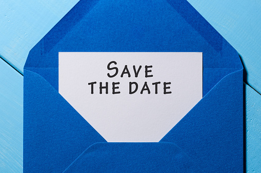 istock Text Save the date on white paper at blue envelope. business concept 671376112