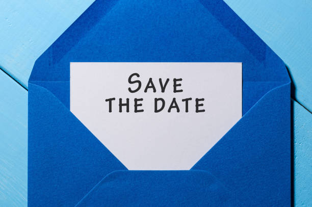 Text Save the date on white paper at blue envelope. business concept stock photo