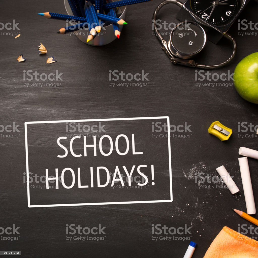 Text School Holidays And School Supplies On Chalk Board Top View