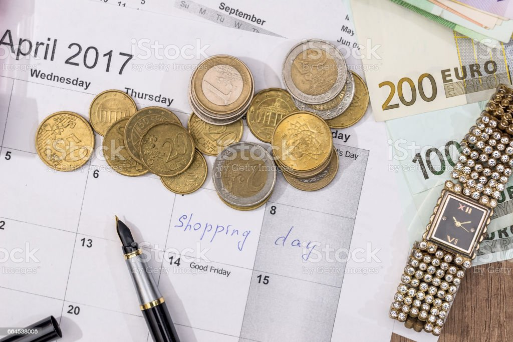 text shopping day write on calendar with euro banknotes, coin, pen. royalty-free stock photo