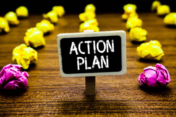 Text sign showing Action Plan. Conceptual photo list of things or schedule to be made thia current year Blackboard crumpled papers several tries mistake not satisfied wooden floor. stock photo