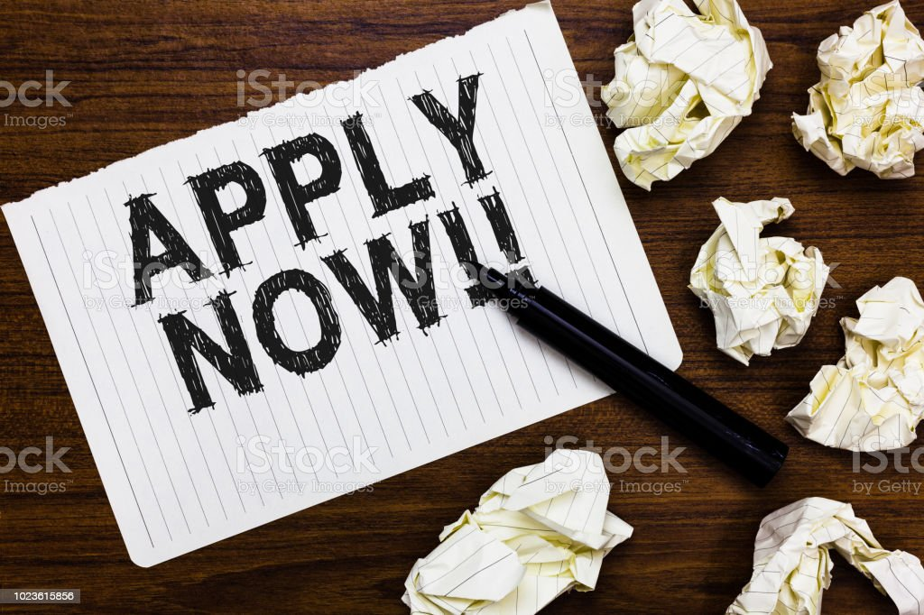 Text sign showing Apply Now. Conceptual photo Make a formal application for a job right away Take action Marker over notebook crumpled papers ripped pages several tries mistakes stock photo