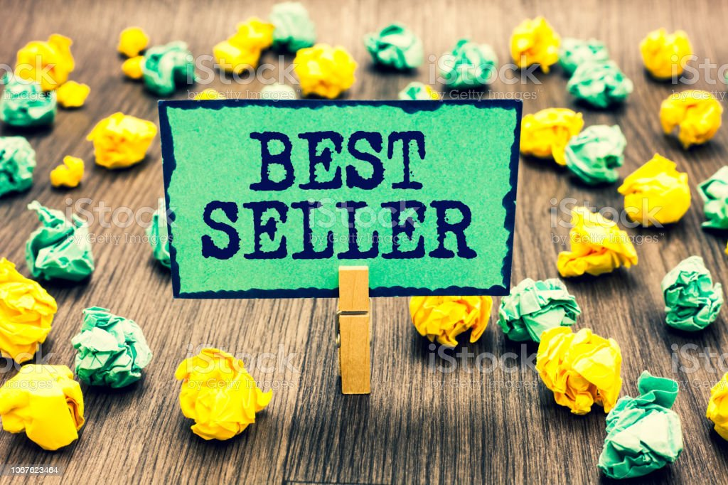 Text sign showing Best Seller. Conceptual photo book or other product that sells in very large numbers Clothespin holding green note paper crumpled papers several tries mistakes. stock photo