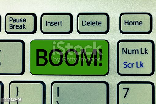 istock Text sign showing Boom. Conceptual photo Loud Deep resonant sound Sudden economic growth Abrupt Expansion 1045432406