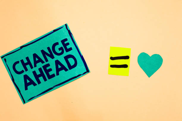 Text sign showing Change Ahead. Conceptual photo Some alterations waiting to happen Perspective Standby Turquoise piece paper reminder equal sign heart sending romantic feelings. stock photo