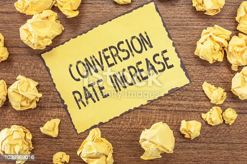 1131526784 istock photo Text sign showing Conversion Rate Increase. Conceptual photo Ratio of Total Visitors who perform desired actions 1039969016