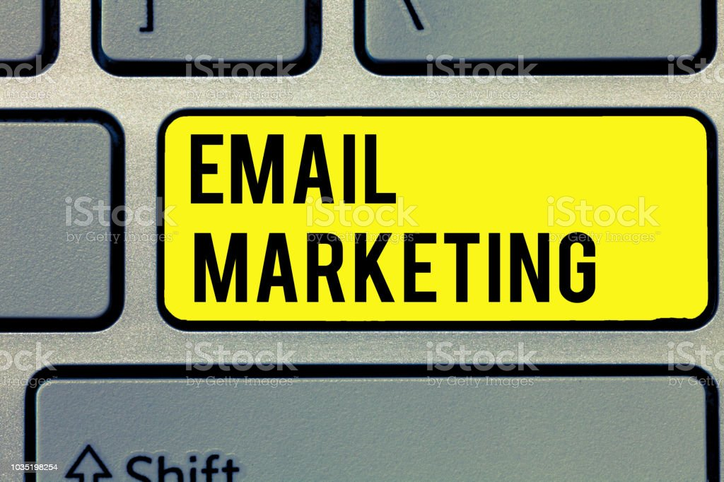 Text sign showing Email Marketing. Conceptual photo Sending a commercial message to a group of people using mail stock photo