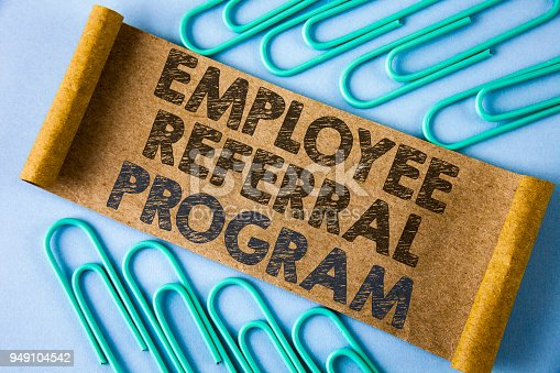 istock Text sign showing Employee Referral Program. Conceptual photo strategy work encourage employers through prizes written on Folded Cardboard paper piece on plain blue background within Paper Pins. 949104542