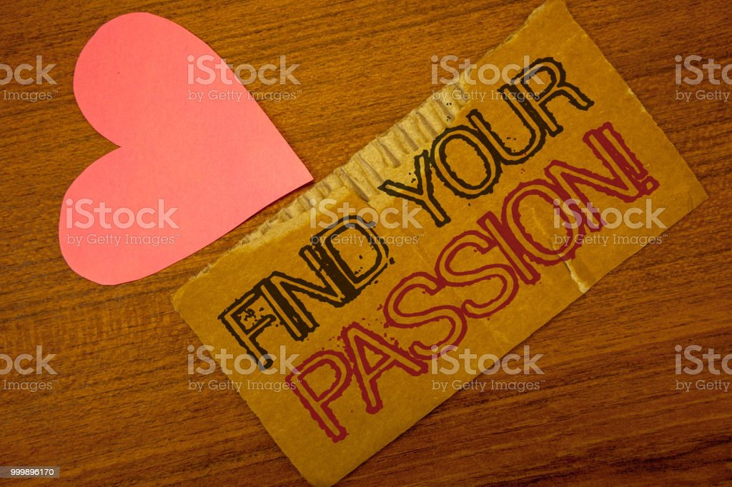 Text sign showing Find Your Passion Motivational Call. Conceptual photo encourage people find their dream Peru color torn page with engraved black red text woody desk pink heart. stock photo