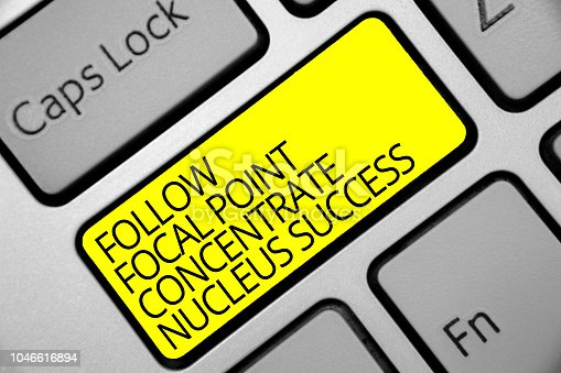 istock Text sign showing Follow Focal Point Concentrate Nucleus Success. Conceptual photo Concentration look for target Keyboard yellow key Intention create computer computing reflection document. 1046616894