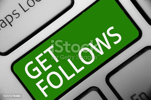 istock Text sign showing Get Follows. Conceptual photo person who imitates copies or takes as model ideal person Keyboard green key Intention create computer computing reflection document. 1022078460