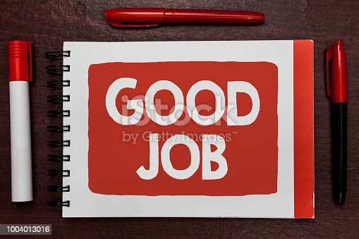 istock Text sign showing Good Job. Conceptual photo encourage someone for his effort hard work winning or success Important ideas highlighted notebook markers wooden table reminder message. 1004013016
