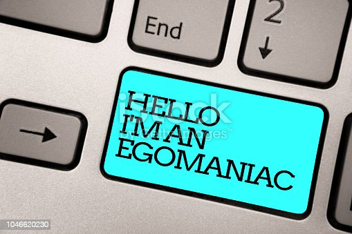 Text sign showing Hello I am An Egomaniac. Conceptual photo Selfish Egocentric Narcissist Self-centered Ego Silver grey computer keyboard with blue button black color written text