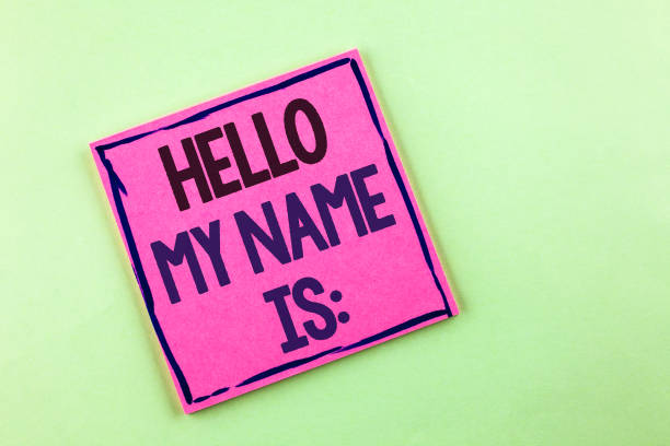 Text sign showing Hello My Name Is. Conceptual photo meeting someone new Introduction Interview Presentation written on Pink Sticky Note Paper on the plain background. stock photo