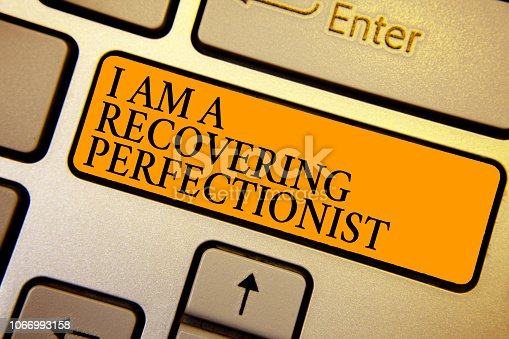 istock Text sign showing I Am A Recovering Perfectionist. Conceptual photo Obsessive compulsive disorder recovery Keyboard orange key Intention create computer computing reflection document. 1066993158