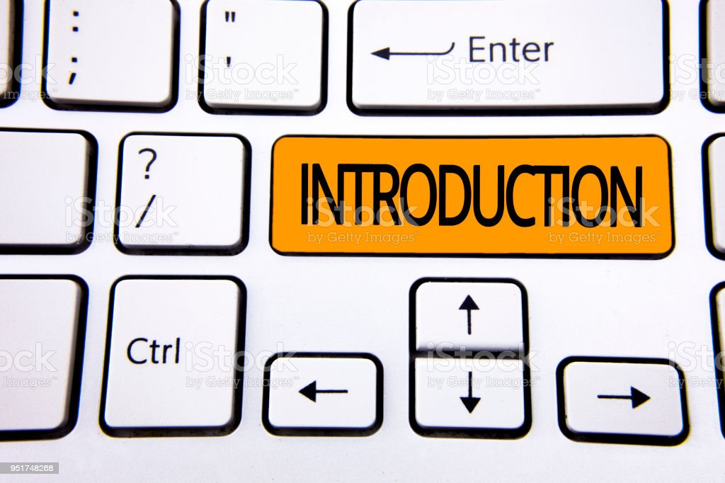 Text sign showing Introduction. Conceptual photo First part of a document Formal presentation to an audience written on Orange Key Button on White Keyboard with copy space. Top view. stock photo