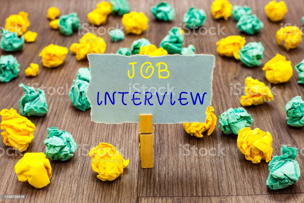 Text sign showing Job Interview. Conceptual photo Assessment Questions Answers Hiring Employment Panel Clothespin holding gray note paper crumpled papers several tries mistakes. stock photo