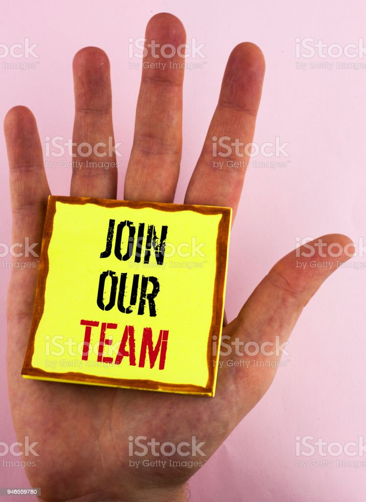 Text sign showing Join Our Team. Conceptual photo Get over unemployment joining better career workforce written on Yellow Sticky Note Paper placed on the Hand on the plain background. stock photo