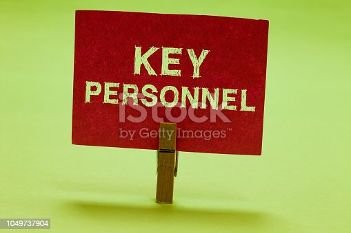 istock Text sign showing Key Personnel. Conceptual photo Program Directors Principal Investigator Project Executives Clothespin holding red paper important communicating messages ideas. 1049737904