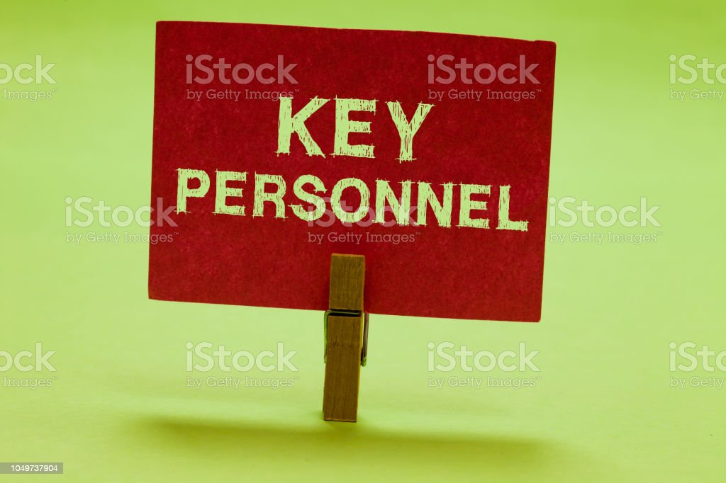 Text sign showing Key Personnel. Conceptual photo Program Directors Principal Investigator Project Executives Clothespin holding red paper important communicating messages ideas. stock photo