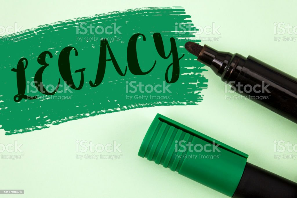 Text sign showing Legacy. Conceptual photo Transmitted Received from an ancestor Money Properties given by will written on Painted Green background Markers next to it. stock photo