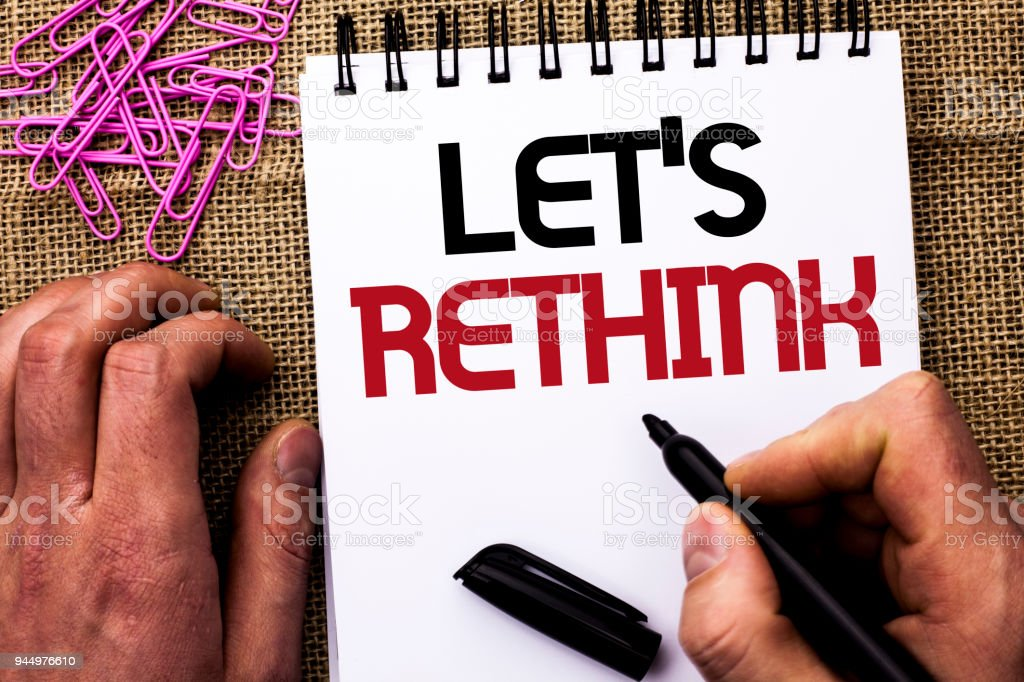 Text sign showing Let Us Rethink. Conceptual photo Give people time to think things again Remodel Redesign written by Man Holding Marker on Notebook Book on the jute background Pins next to it stock photo