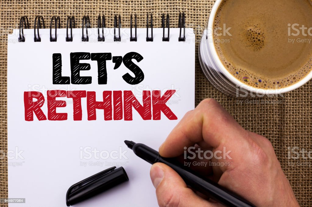Text sign showing Let Us Rethink. Conceptual photo Give people time to think things again Remodel Redesign written by Man Holding Marker on Notebook Book on the jute background Coffee Cup. stock photo