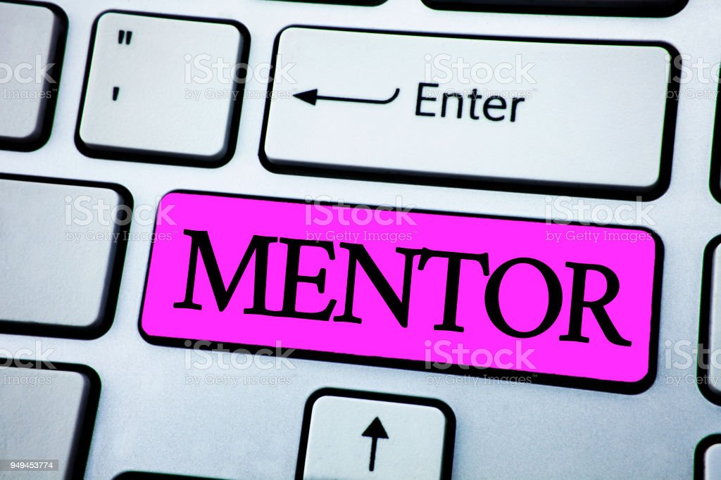 Text sign showing Mentor. Conceptual photo Person who gives advice or support to a younger less experienced written on Pink Key Button on White Keyboard with copy space. Top view. stock photo