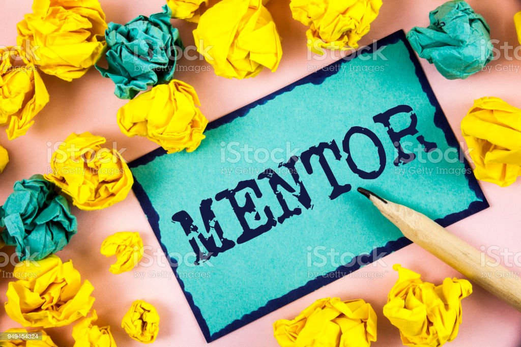 Text sign showing Mentor. Conceptual photo Person who gives advice or support to a younger less experienced written on Sticky Note paper within Paper Balls on plain background Pencil. stock photo