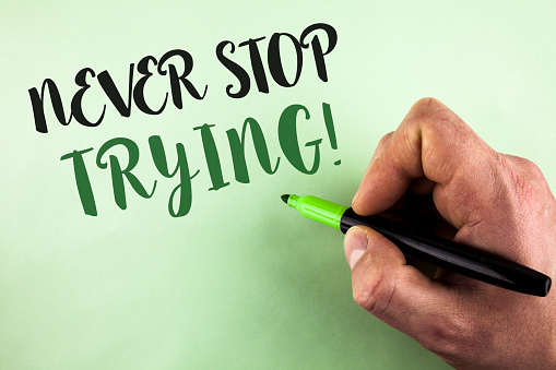 istock Text sign showing Never Stop Trying Motivational Call. Conceptual photo go on do not give up Self confidence written by Man holding Marker in Hand on plain background. 949425244