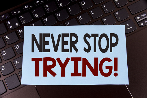 istock Text sign showing Never Stop Trying Motivational Call. Conceptual photo go on do not give up Self confidence written on Sticky Note Paper placed on the Laptop. 949431488
