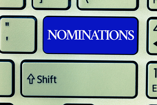 istock Text sign showing Nominations. Conceptual photo Suggestions of someone or something for a job position or prize 1056065742