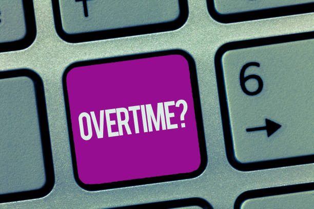 Text sign showing Overtime question. Conceptual photo Time worked in addition to regular working hours stock photo