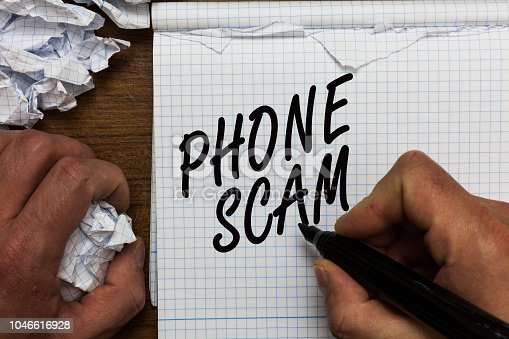 Text sign showing Phone Scam. Conceptual photo getting unwanted calls to promote products or service Telesales Man holding marker notebook crumpled papers ripped pages mistakes made