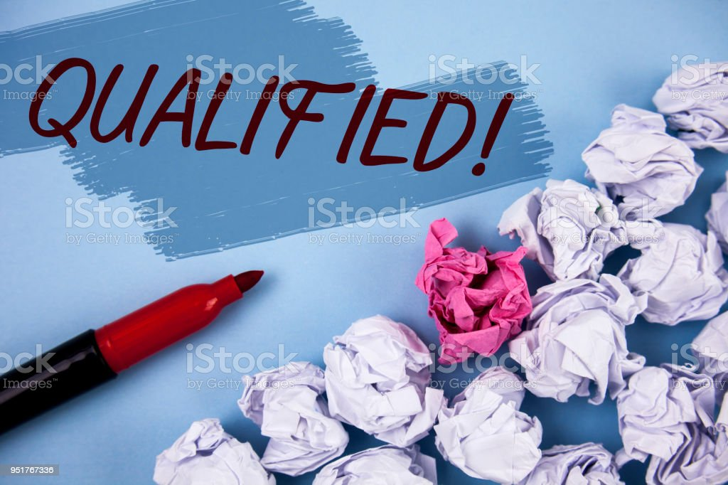 Text sign showing Qualified Motivational Call. Conceptual photo Certified to perform a job Competent Experienced written on Painted background Crumpled Paper Balls and Marker next to it. stock photo