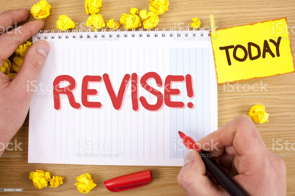 Text sign showing Revise Motivational Call. Conceptual photo Reconsider something to improve it Review written by Man on Notepad holding  Marker on wooden background Today Paper Balls, stock photo