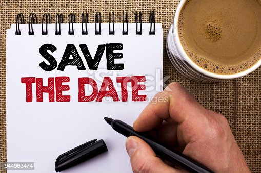 istock Text sign showing Save The Date. Conceptual photo Remember not to schedule anything else that time Appointment written by Man Holding Marker on Notebook Book on the jute background Coffee Cup. 944983474