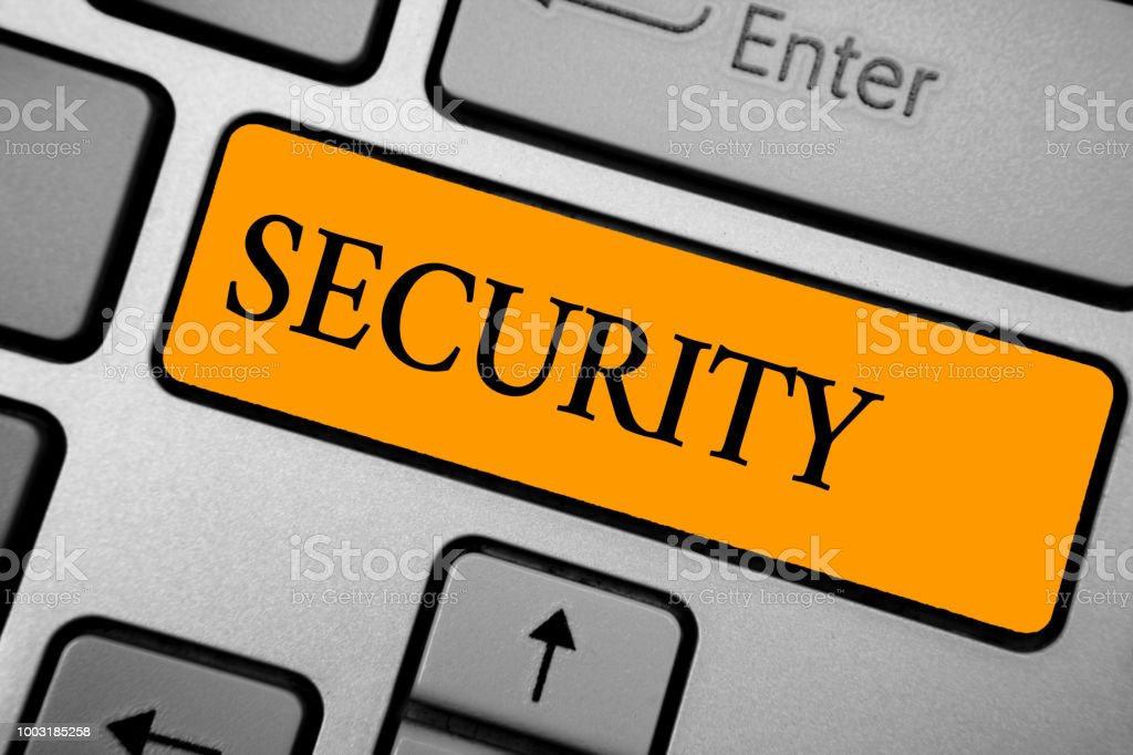 Text sign showing Security. Conceptual photo The state of feeling safe stable and free from fear or danger Keyboard orange key Intention create computer computing reflection document. stock photo