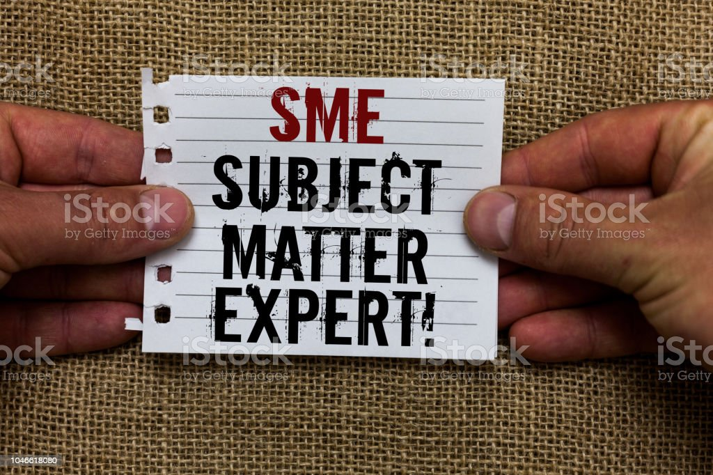Text sign showing Sme Subject Matter Expert. Conceptual photo Authority in a particular area or topic Domain Man holding piece notebook paper jute background Communicating ideas. stock photo
