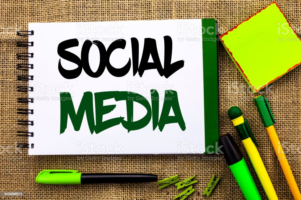 Text sign showing Social Media. Conceptual photo Communication Chat Online Messaging Share Community Societal written on Notebook Book on the jute background Pens Clips Sticky Note next to it. stock photo