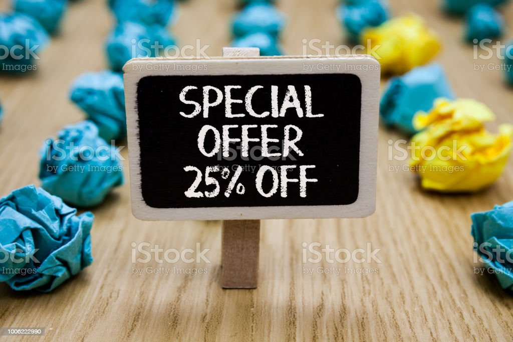 Text sign showing Special Offer 25 Off. Conceptual photo Discounts promotion Sales Retail Marketing Offer Paperclip hold written chalkboard behind paper lumps on woody deck. stock photo