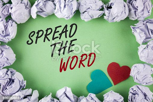istock Text sign showing Spread The Word. Conceptual photo Run advertisements to increase store sales many fold written on plain green background within White Paper Balls Hearts next to it. 946560654
