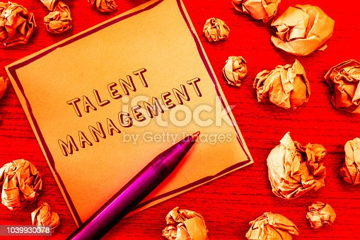 istock Text sign showing Talent Management. Conceptual photo Acquiring hiring and retaining talented employees 1039930078