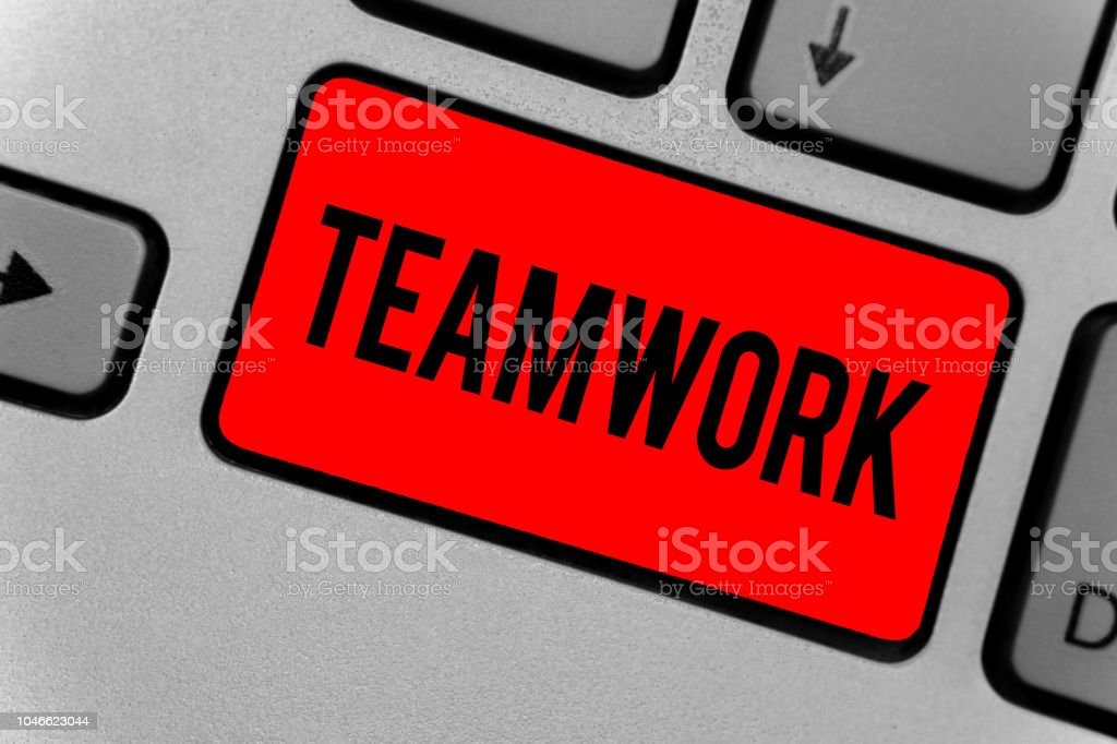 Text sign showing Teamwork. Conceptual photo Group of people who work together as one and with the same aim Keyboard red key Intention create computer computing reflection document. stock photo