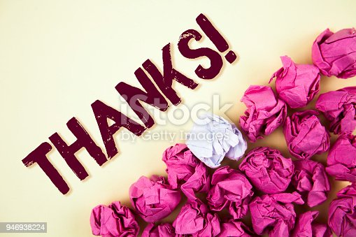 1068057218 istock photo Text sign showing Thanks Motivational Call. Conceptual photo Appreciation greeting Acknowledgment Gratitude written on Plain background Crumpled Paper Balls next to it. 946938224