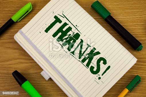 1068057218 istock photo Text sign showing Thanks Motivational Call. Conceptual photo Appreciation greeting Acknowledgment Gratitude written on Notebook Book on the wooden background Pen and Markers next to it. 946938342