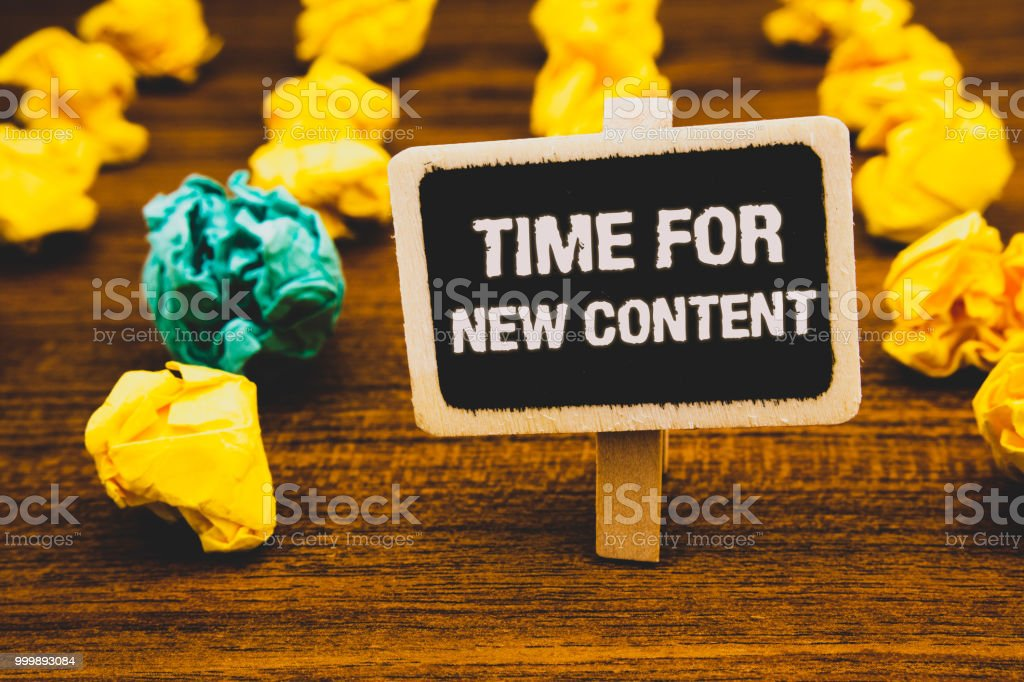 Text sign showing Time For New Content. Conceptual photo Copyright Publication Update Concept Publishing Blackboard with letters wooden floor blurry yellow paper lumps green lob. stock photo