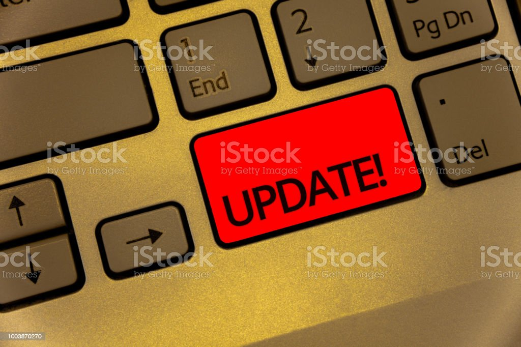 Text sign showing Update Motivational Call. Conceptual photo Up to date with latest developments updated Keyboard brown key yellow laptop creative computer keypad netbook notebook. stock photo