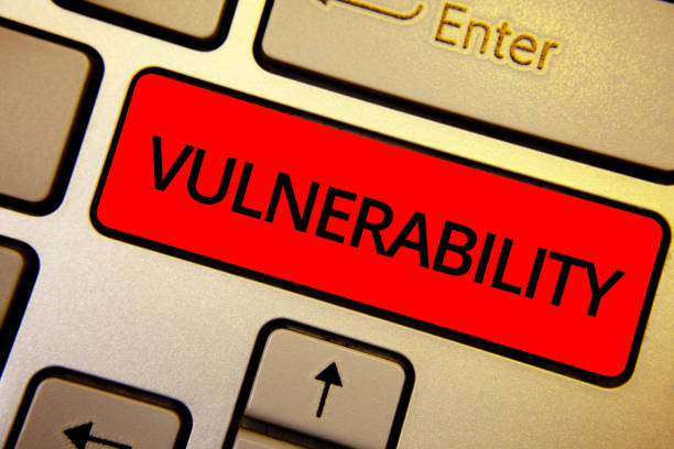 Text sign showing Vulnerability. Conceptual photo Information susceptibility systems bug exploitation attacker Keyboard brown keys yellow laptop idea create computer keypad laptop. stock photo